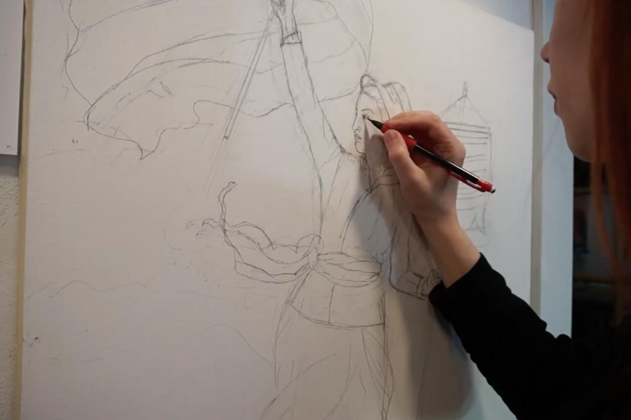 Image of artist working on artwork.